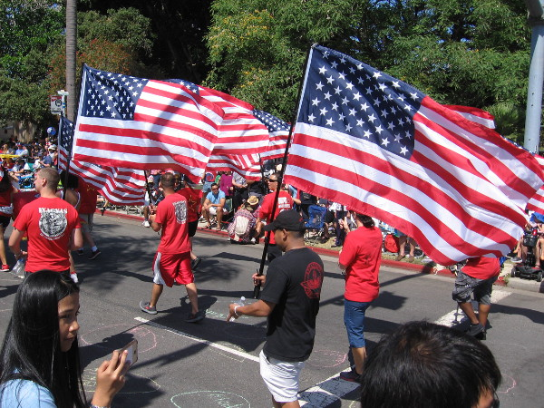 Flags move forward down Orange Avenue during the 2018 Fourth of July Parade in Coronado.