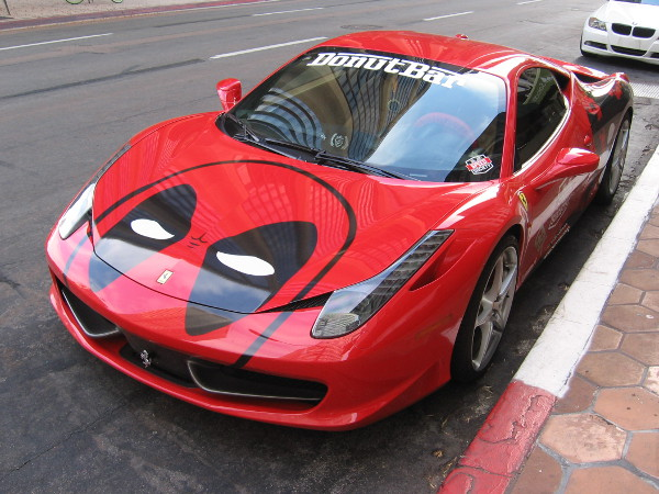 Chef Santiago of the Donut Bar has his cool Deadpool Ferrari parked on B Street.