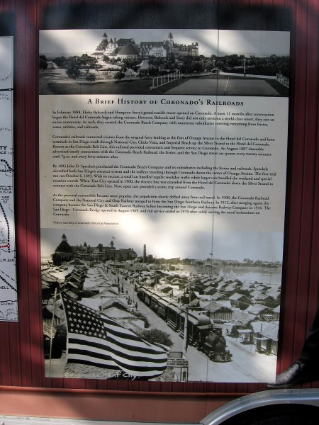 Sign describes the history of Coronado's railroads. John D. Spreckels built a line that went up the Silver Strand, bringing passengers to the Hotel del Coronado and Tent City.