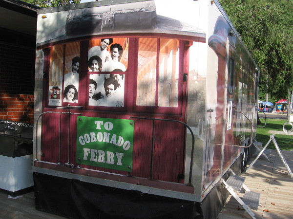 Graphic on restroom trailer shows the faces peering from a streetcar that ran along Orange Avenue to the original ferry landing.