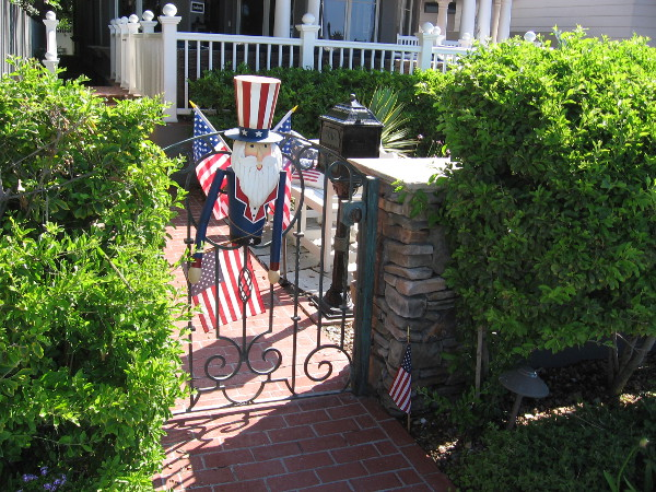 A smiling Uncle Sam at someone's front gate.