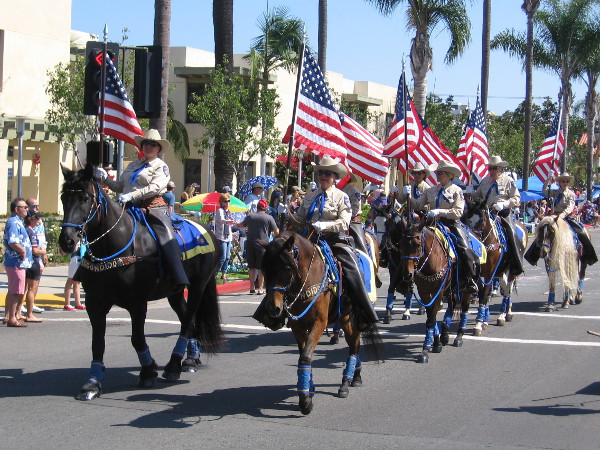 Members of San Diego County law enforcement come down the parade route on horseback.