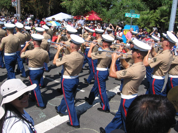 Military heroes march by on Independence Day.