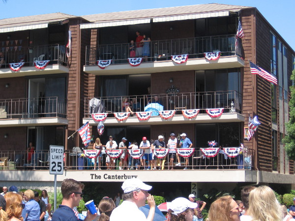 People watch the big parade from a building on Orange Avenue.