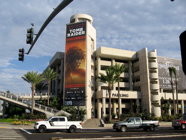 A prominent banner facing downtown promotes the upcoming video game Shadow of the Tomb Raider.