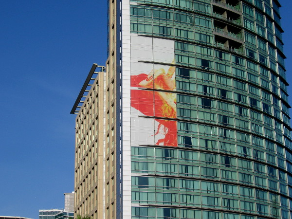 A building wrap on the Omni Hotel is just getting started. Looks to me like it promotes The Gifted.