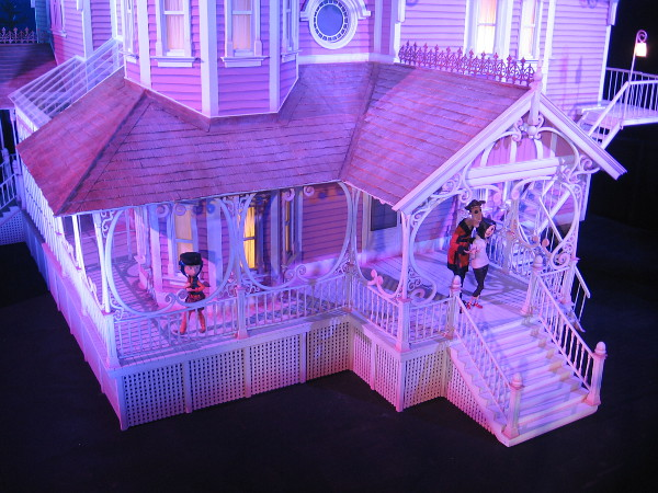 A closer look, with models of Coraline characters on the porch.