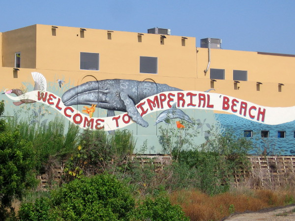 As drivers head west down Palm Avenue, a mural featuring a gray whale welcomes them to Imperial Beach.