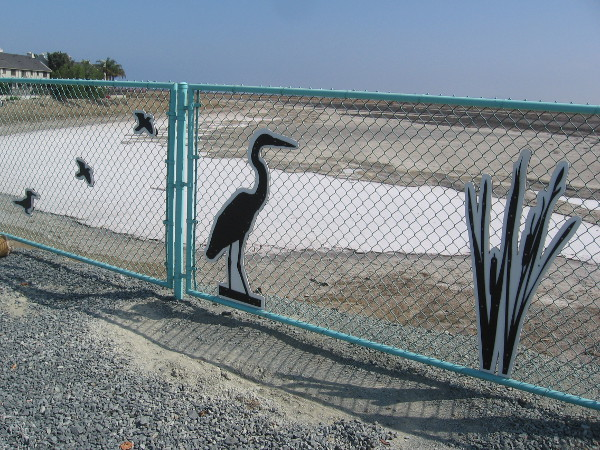 Art on fence between Palm Avenue and the old salt ponds of south San Diego Bay, now part of the San Diego Bay National Wildlife Reserve.