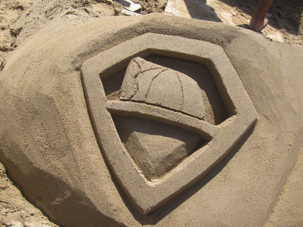 The I.B. Posse created a new chest emblem for Superman. It features a firefighter's helmet.