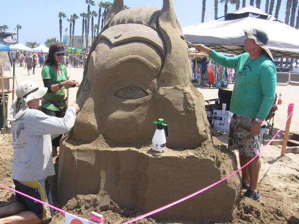 This sculpture by the San Squirrels honors a former member. I believe her name was Shera. Her surviving brother works with sand for the first time.