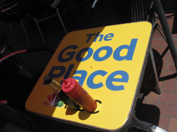 On Friday I spoke briefly to a guy putting The Good Place stickers on the Tin Fish's outdoor tables.