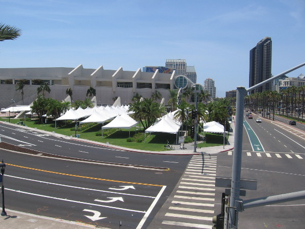 Crossing the Harbor Drive pedestrian bridge, I see the tents outside the San Diego Convention Center are already set up.