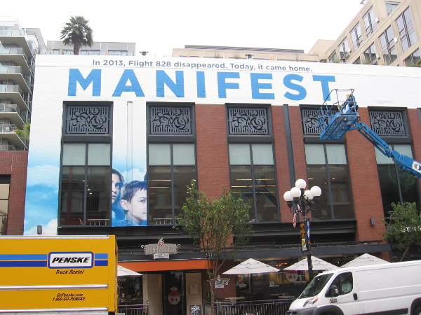 Manifest, an upcoming NBC television series, promoted on a building wrap being applied to the Hard Rock Hotel in San Diego for 2018 Comic-Con.