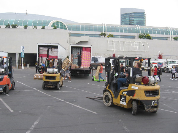 Comic-Con exhibitors were unloading their stuff as a small fleet of forklifts zipped about.