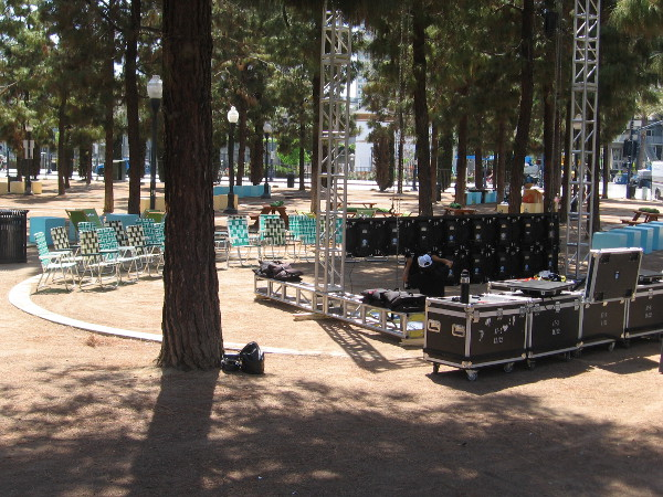 Lawn chairs face a stage.