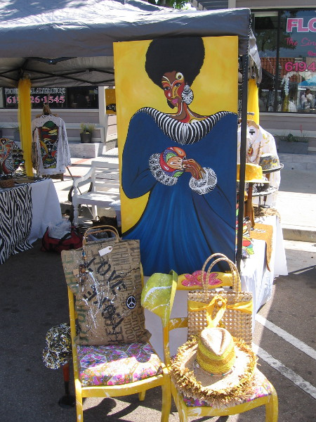 Artists at the Lemon Festival had all sorts of colorful artwork for sale that contained bright yellow.