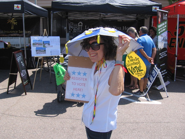 This lady registering people to vote had a cool lemon slice umbrella hat and smile.