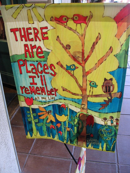 There Are Places I'll Remember All My Life. A colorful banner near door to the Balboa Park Visitors Center.