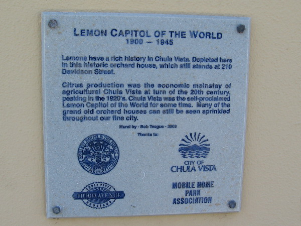 Plaque by mural explains the role of lemons in the history of Chula Vista. Many grand old orchard houses can still be seen around the city.