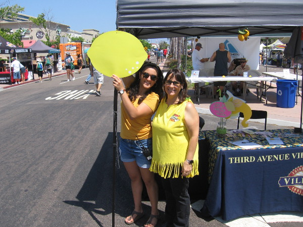 The festival had just started and these ladies with the Third Avenue Village Association, that puts on the popular event, were putting the finishing touches on their booth.