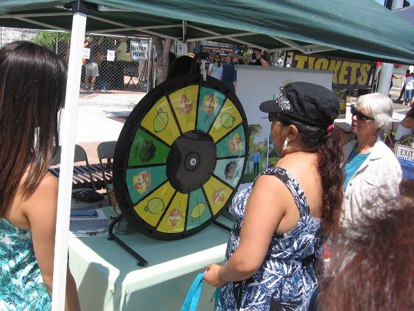 Meanwhile, people spin a lemon-themed prize wheel at the festival.