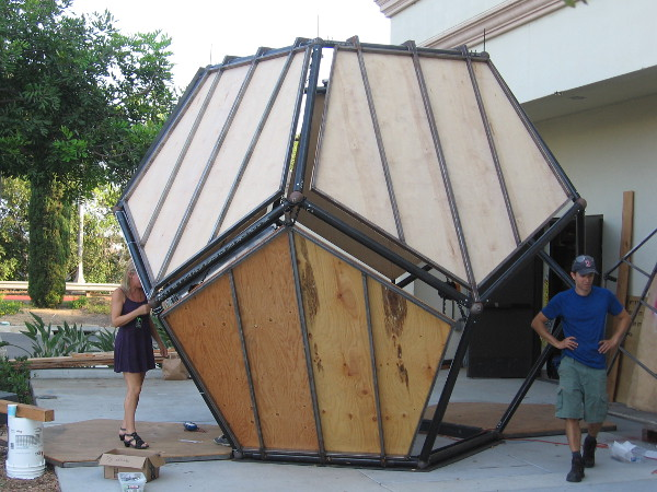 Exterior panels haven't been attached to this side of the enormous Unfolding Humanity dodecahedron yet.