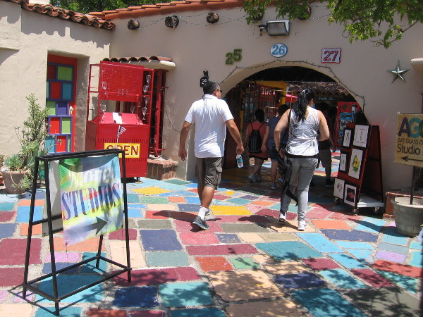 Visitors to the Spanish Village Art Center in Balboa Park walk through a sunlit paradise of color and creativity.