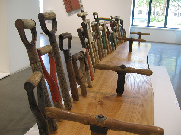 Dig for Three, 2015, walnut and shovel handles by artist Tom Loeser.