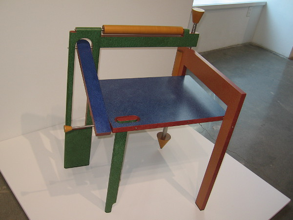 Folding Chair, 1987, painted plywood, maple, stainless steel by artist Tom Loeser.