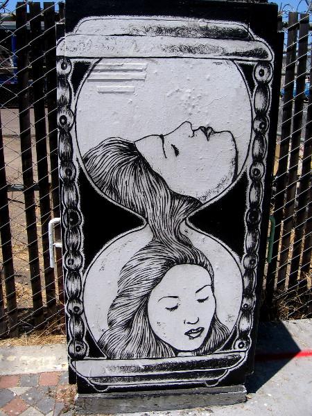 Female face flows like sand through an hourglass. Beautiful street art on a utility box on Cesar E. Chavez Parkway in Barrio Logan.