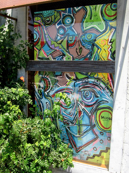 Cool art enlivens a nearby window.