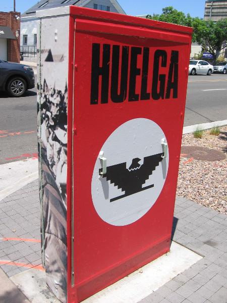 Huelga in Spanish means strike.