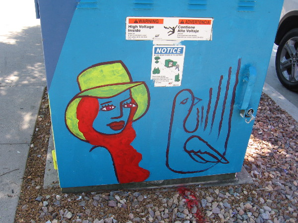 Fun street art on another side of the electrical box on Cesar E. Chavez Parkway includes a face.
