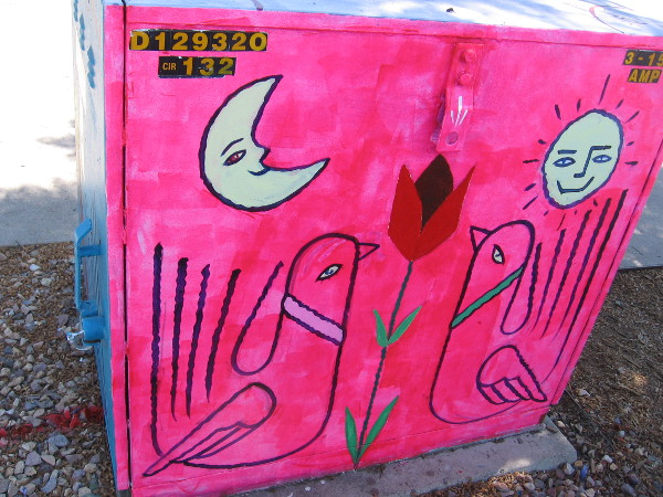 Another side. Two birds, a red flower, the moon and sun.
