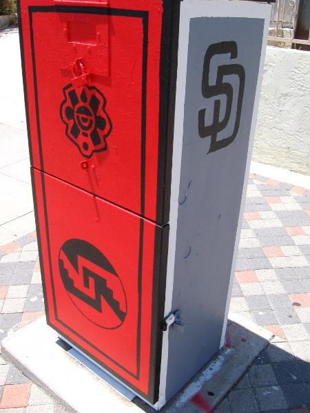 Among many symbols in the Barrio Logan street art, I spy the logo of the San Diego Padres!