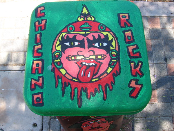 Chicano Rocks--looks sort of like an Aztec version of the rock band KISS.