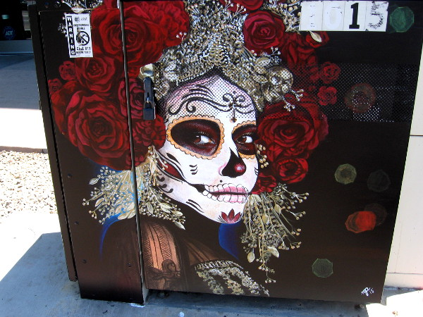 Amazing street art in Barrio Logan. Painting of a face decorated for Día de Muertos, or Day of the Dead.