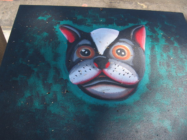 Dog's head street art.