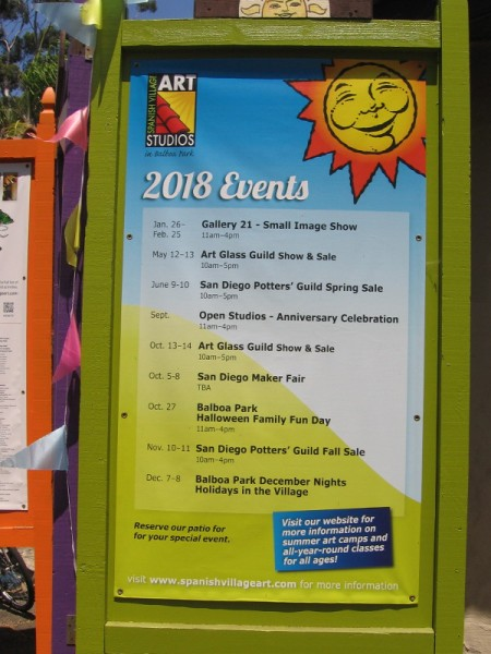 Sign lists 2018 events, including special shows and sales, in Spanish Village Art Studios in Balboa Park.