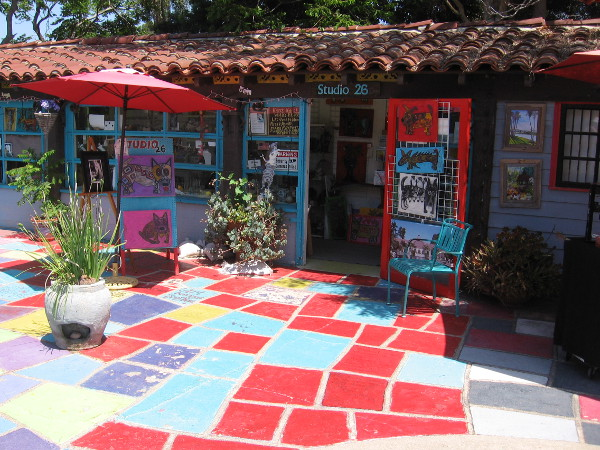 Patio tiles leading visitors to the front door of Studio 26 seem like a Yellow Brick Road of many colors.
