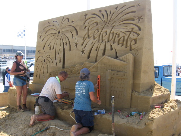 A sand sculpture rises at the foot of Broadway Pier in San Diego. It depicts fireworks above the Port Pavilion, site of the 2018 U. S. Sand Sculpting Challenge on this upcoming Labor Day weekend!