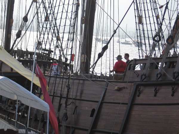 People enjoy a look inside the Spanish galleon replica San Salvador.