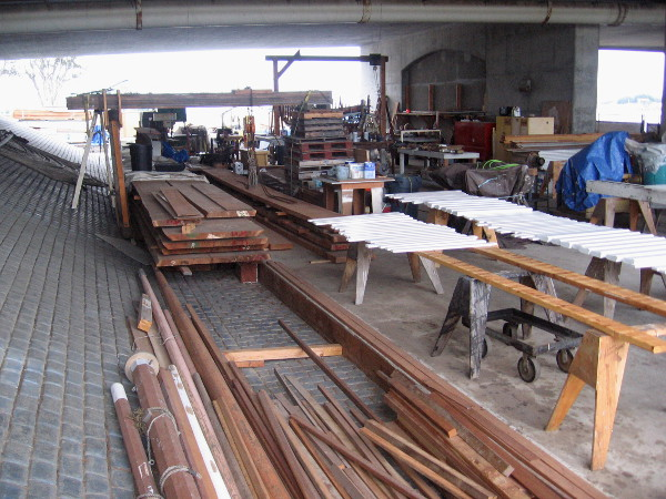 All sorts of wood can be found under the North Harbor Drive Bridge, where the historic boat Butcher Boy is undergoing a thorough restoration.