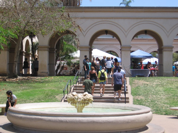 People head up toward the Casa del Prado's outdoor courtyard to enjoy another special event in Balboa Park.