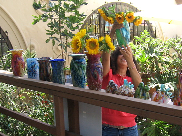 Someone admires a glass vase created by the friendly glassblowers in Studio 19.