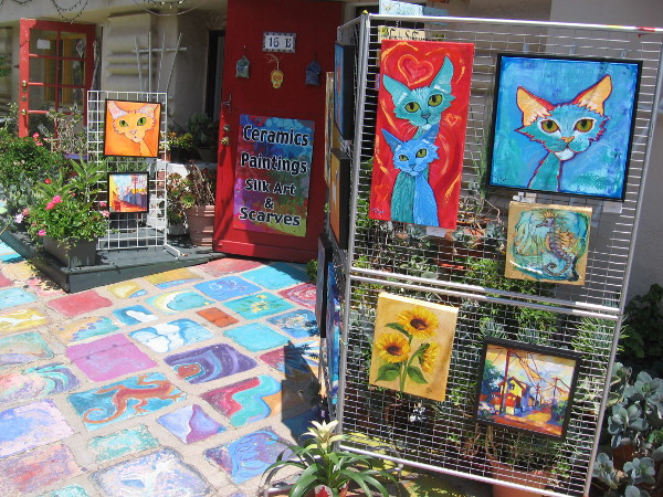 Colorful cats have gathered on the patio in front of Studio 16 in Spanish Village.