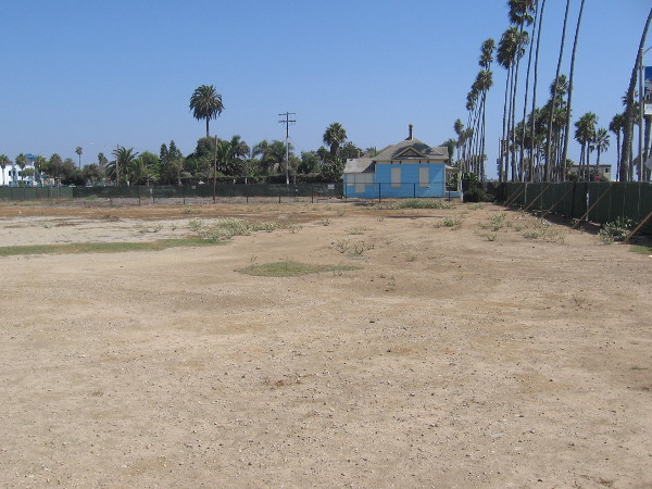 The Top Gun beach house sits in a corner of a large empty lot that is awaiting development. A hotel will be built here, a block from the Oceanside Pier.
