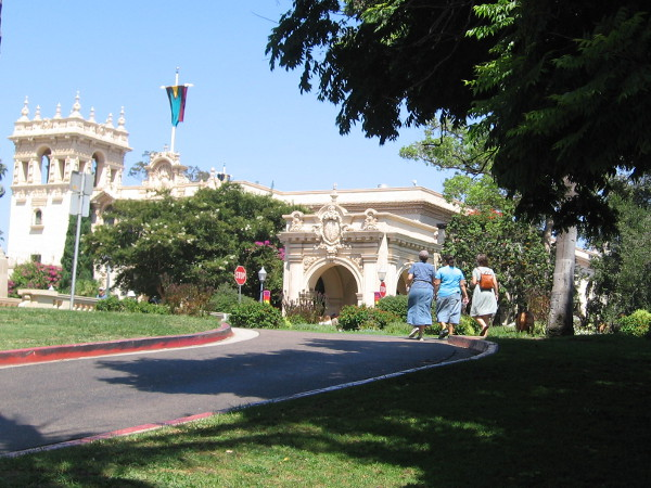 Visitors to Balboa Park walk toward the Plaza de Panama.