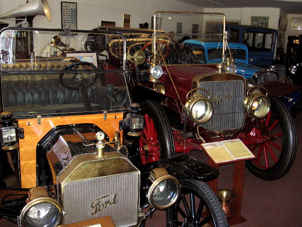 Upon entering the J. A. Cooley Museum, visitors walk past a row of very old cars. On the left is a 1914 Ford Model T.